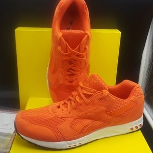 Orange  and white Reebok's sneakers